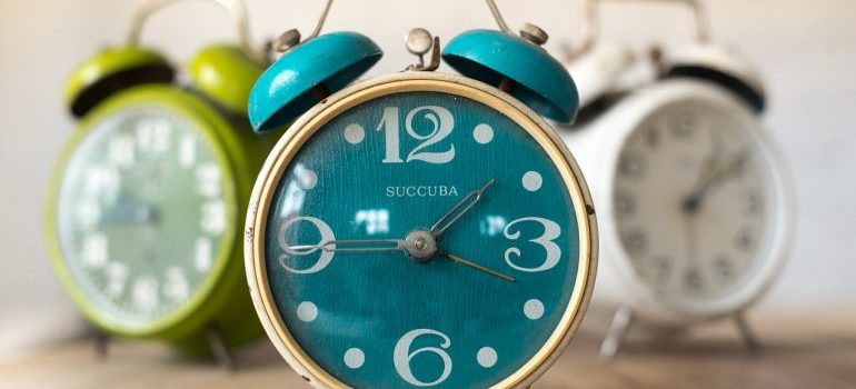 Three alarm clocks.