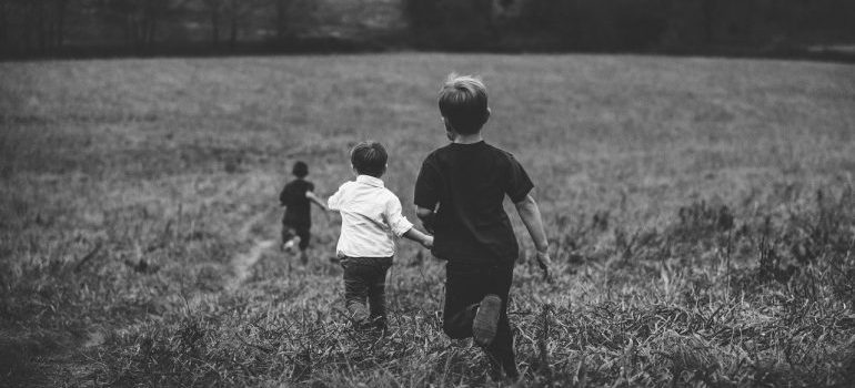 boys running in the field