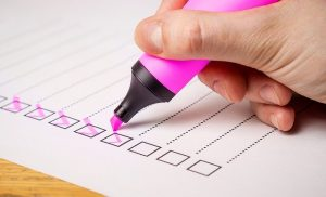 marker checking a checklist
