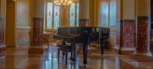 A piano in a Victorian-styled room.