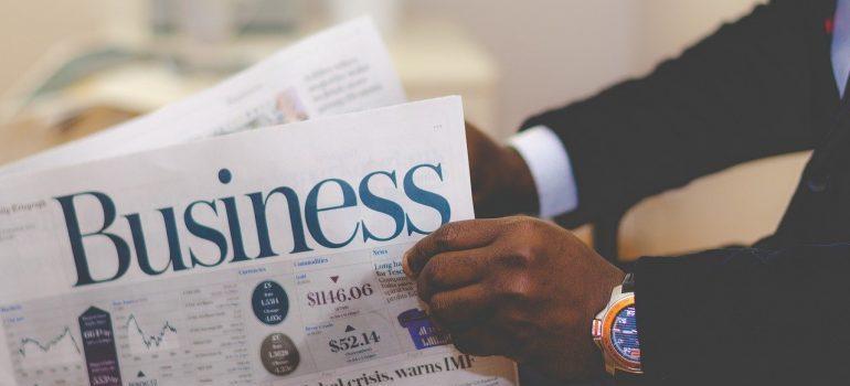 A man reading a business journal.