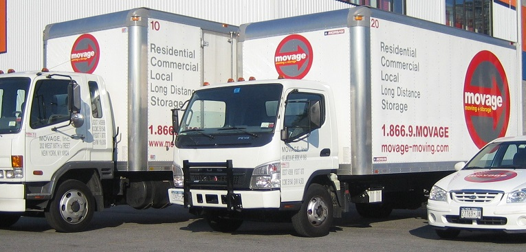 moving trucks, representing ground freight shipping services nyc