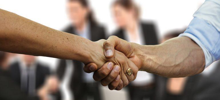 A handshake between Bergen County movers.