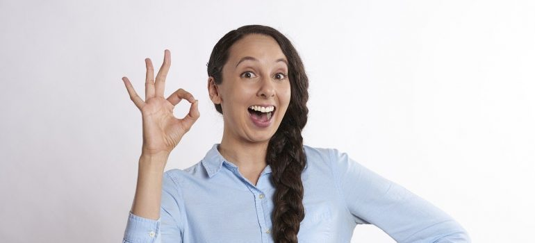 A woman showing an okay sign.