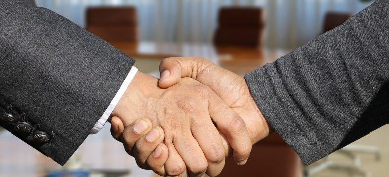 Movers Passaic NJ shaking hands.