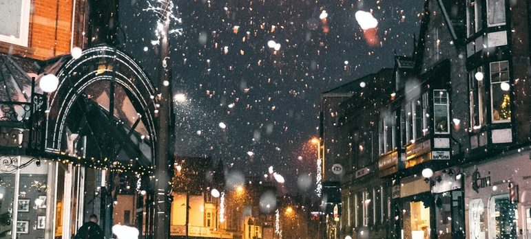 Snow falling in the city at night