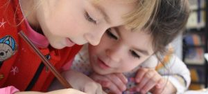 moving to Closter with your family - kids looking and writing