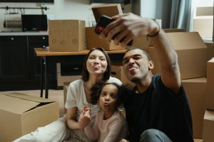 A family taking picture after moving in