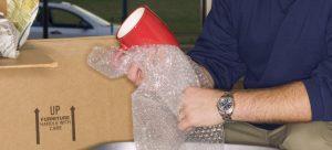 Man unpacking moving box