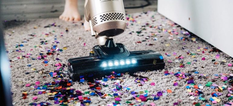 Vacuuming after a housewarming party that needs to be on the post-move checklist