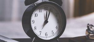 Black and white alarm clock on a desk