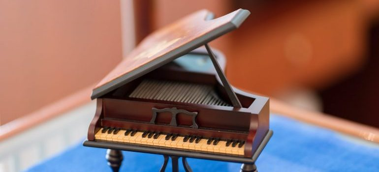 Model of a piano showing size and shape that represent challenges of moving your piano in NJ