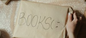 Books wrapped in a packing paper