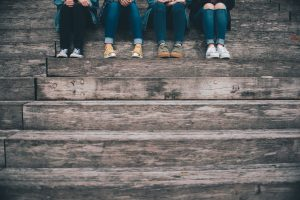 Four teenage girls sitting on the stairs