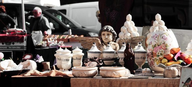 Many ceramic items being sold on yard sale