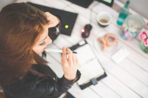 a girl writing a list
