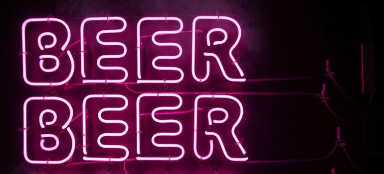 Neon sign with the word beer written three times