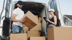 A man and woman with moving boxes