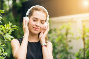 A music lover listening to the best entertainment for music lovers in NYC