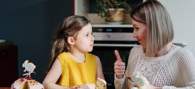 woman talking with a child
