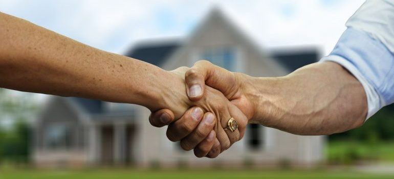 a handshake - deal with unpleasant neighbors