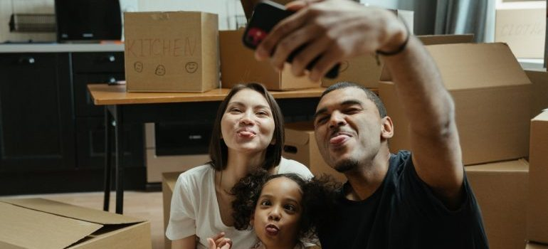 Family taking a photo after packing