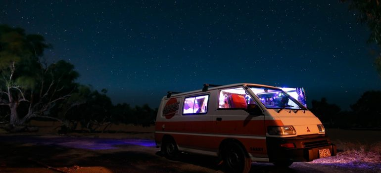 Family camper and a beautiful night sky in the background