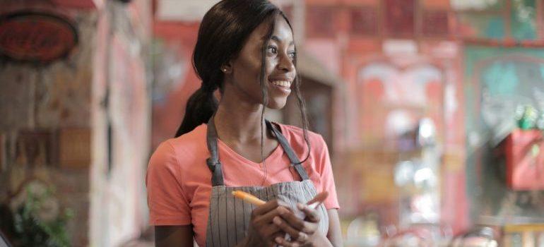 a smiling waitress taking order