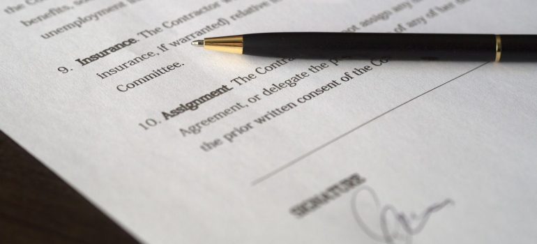 a picture of a contract and a black pen on top of it