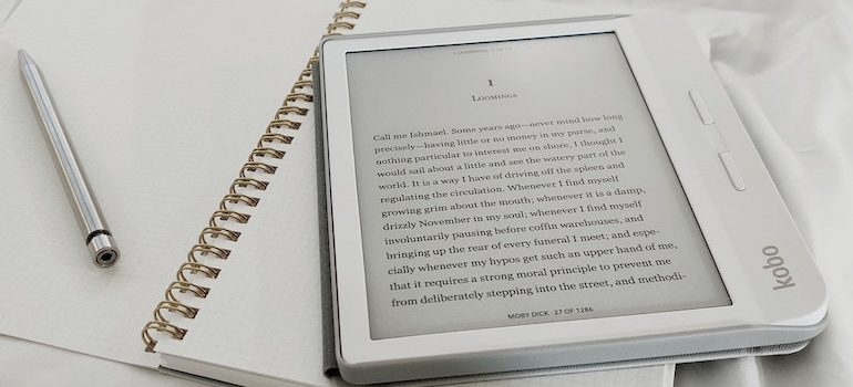 Ebook on a notebook and a pen