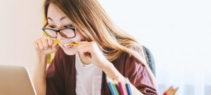 woman bitting a pencil