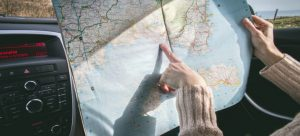 Girl with map want to accurately book a move in advance