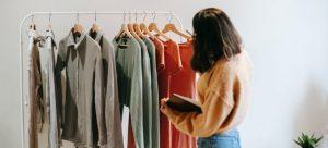 A woman decluttering her wardrobe.