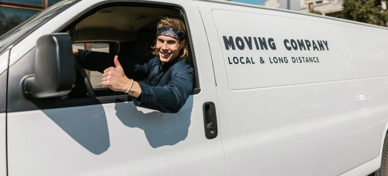 A professional mover in a van