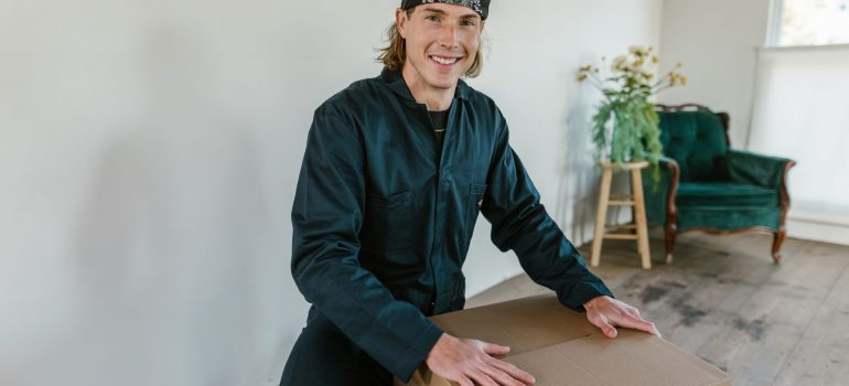 A man next to a cardboard box