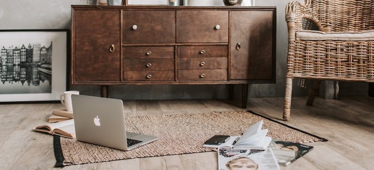 old chest of drawers, and the floor next to it MacBook and magazines