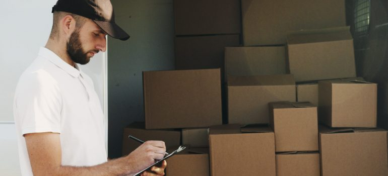 Picture of a moving professional. The easiest way to organize the unpacking process is to call reliable moving partners
