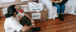 Man and woman packing items