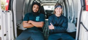 Two man sitting in a van.