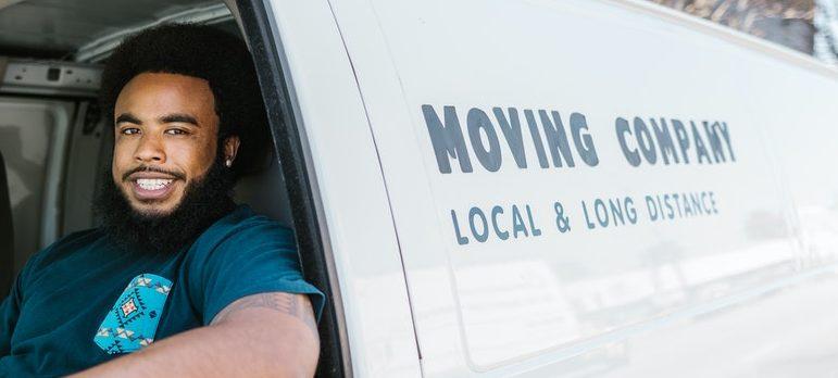 Two guys sitting in a van