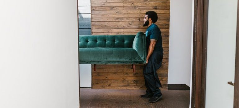 man holding couch