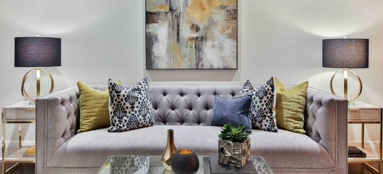 grey sofa bed with colorful pillows