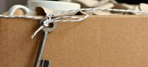 The key to the house tied to a cardboard box