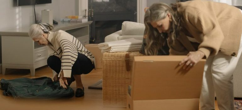 Two women packing.
