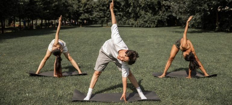 People doing yoga as one of many fun summer activities in Fort Lee