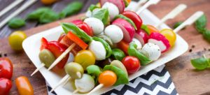Skewers of fruit and vegetables on the plate