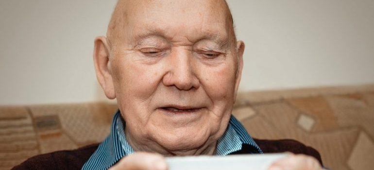 senior man looking at the phone