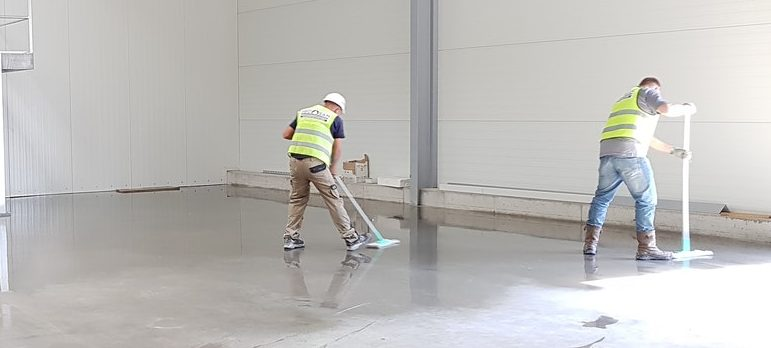 Three people cleaning