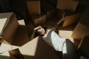 A woman with cardboard boxes.