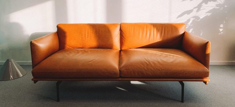 Orange leather sofa is one of the items that should be stored in climate controlled units